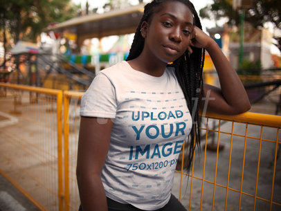 Mockup of a Black Girl with Dreadlocks Waiting for Someone While Wearing a Round Neck Tee Outdoors a15957