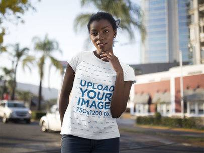 Beautiful Black Girl Wearing a Round Neck Tshirt Mockup While Posing in the City a16056
