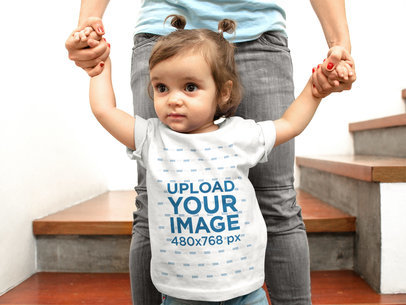 Little Baby Going Down Some Stairs with her Mom While Wearing a Round Neck Tee Mockup a16081