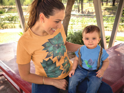 Mom and her Baby Wearing T-Shirts Mockup while Outdoors a16092