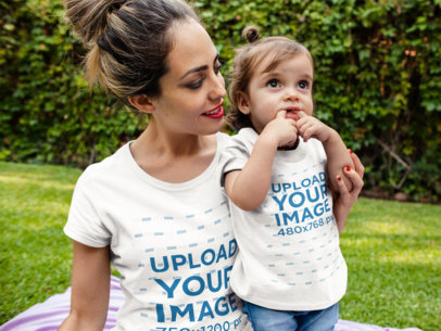 Mockup of a Mom and her Baby Wearing Different Round Neck Tees Mockup While Outdoors a16075
