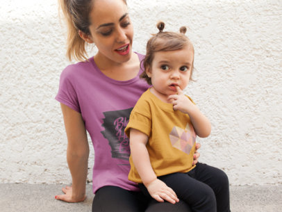Mom with her Daughter Wearing Different T-Shirts Mockup While Sitting Down a16098