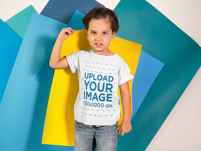 Kid Making an Angry Face While Holding a Yellow Paper on his Back Wears a T-Shirt Mockup a16144