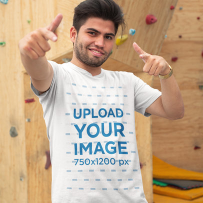 Mockup of a Cool Guy Wearing a T-Shirt While Near a Climbing Wall a16130