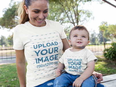 Template of a Woman with her Baby Wearing Different Tshirts Mockup While at the Park a16101