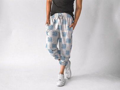 Man with White Sneakers Wearing Sweatpants Mockup in a Studio a15608