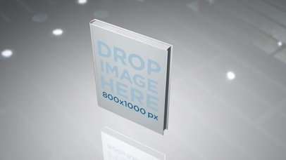 Video of a Hard Cover Book Floating Inside a White Room a16348