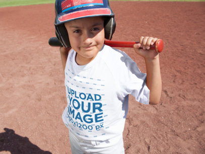 Baseball Uniform Designer - Kid with Helmet and Bat Wearing a Raglan T-Shirt a16368