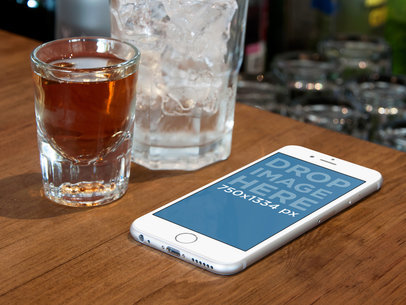 White iPhone 6 On Wooden Counter Bar