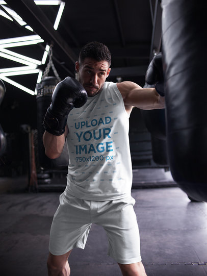 Mockup of a Man Hitting the Bag While Wearing Custom Sportswear a16803