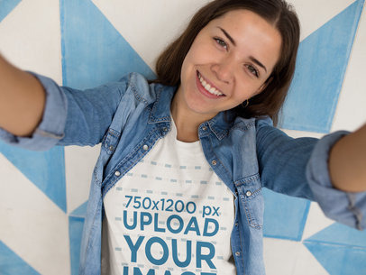 Happy Girl Taking a Selfie Against a Wall While Wearing a Tshirt Template a16918