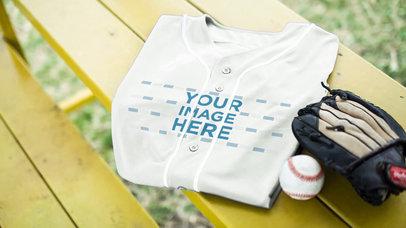 Baseball Uniform Builder - Folded Jersey Lying on a Bench a16932
