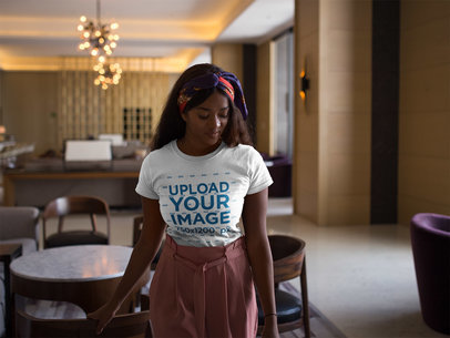 Mockup of a Black Girl Wearing a T-Shirt While Walking in the Hotel Lobby a17131