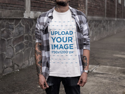 Tattooed Man at a Dangerous Neighborhood Wearing a Round Neck T-Shirt Mockup a17073