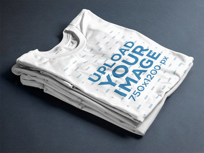 T-Shirt Mockup Folded Over Two Tees on a Table a17241