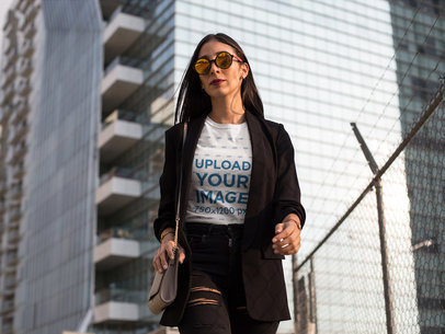 Hispanic Woman Wearing a Tshirt Mockup While Walking in the City a17249