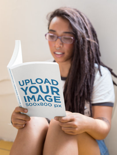 Black Girl with Dreadlocks and Glasses Reading a Book Mockup a17307