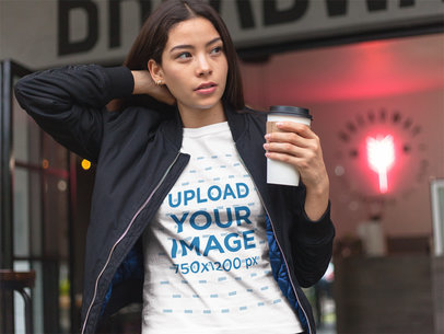 Pretty Asian Girl Buying a Coffee While Wearing a T-Shirt Mockup a17465