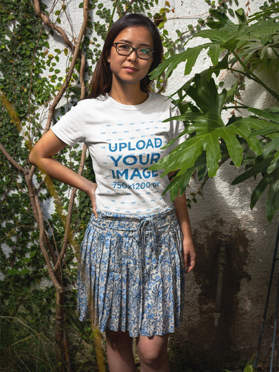 Asian Girl Wearing a T-Shirt Mockup While Next to Plants a17604
