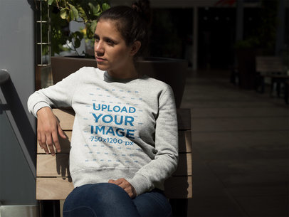 Girl Sitting on a Bench Wearing a Crew Neck Sweatshirt Template a17632