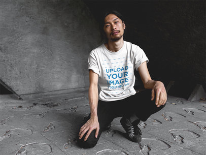 Asian Man with Beard Wearing a Round Neck Tee Template While Crouching a17792