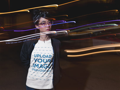 Slow Shutter Photo of a Beautiful Girl Wearing a Tshirt Mockup While at Night a17816