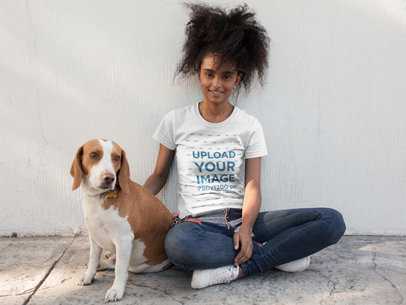 Black Girl Sitting with her Pet Wearing a T-Shirt Mockup a17844