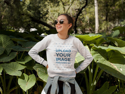 Smiling Girl Wearing a Crew Neck Sweatshirt Template Near Plants a17670