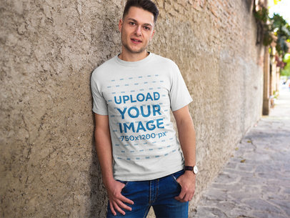 Man Looking to the Camera Wearing a Tshirt Template in the Street a17851