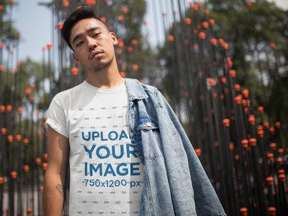 Cool Asian Dude Wearing a Tshirt Template While Near an Urban Art Structure a17832