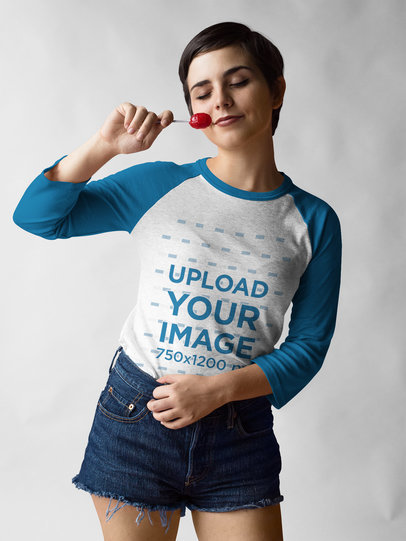 Raglan Tee Mockup Being Worn by a Happy Dancing Girl with a Lollipop a17537