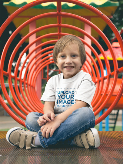 Smiling Little Boy Wearing a Tshirt Mockup While at the Playground a17948