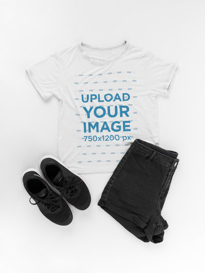 T-Shirt Mockup Next to a Black Outfit on a White Surface a17959
