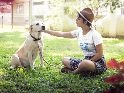 Pretty Girl Wearing a T-Shirt Template while Petting her Dog at a Park a17985