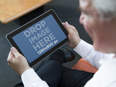 Mockup Template of Elderly Man Using an Android Tablet