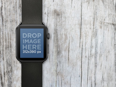 Black Apple Watch Over Wooden Surface Stock Photo