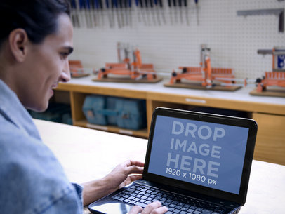 Mockup of Engineer at Industrial Workshop Using an HP Laptop