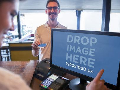 Young Cashier Using PC Desktop for Sales Transaction
