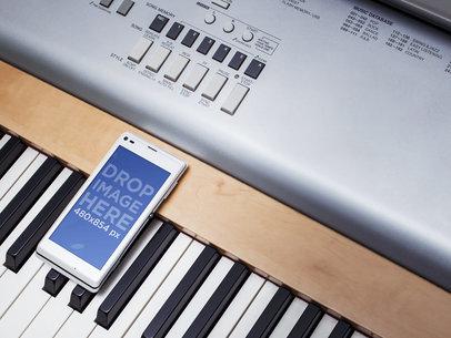 Mockup Template of White Sony Xperia on Piano Keyboard