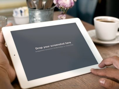 Holding White iPad 2 Coffee
