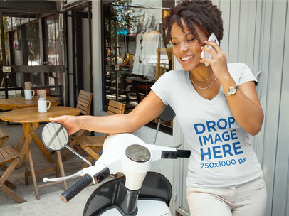 T-Shirt Mockup of a Woman Leaning on Her Motorcycle Next to a Cafe 6608a