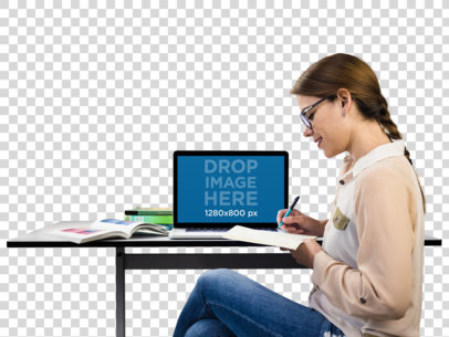 MacBook Mockup of a Young Student Taking Notes a11559