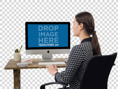 PNG iMac Mockup of a Woman Typing on Her Desktop Computer a11692