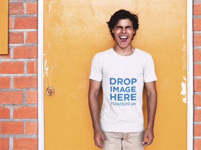 T-Shirt Mockup of a Trendy Young Man Against a Yellow Door a11593