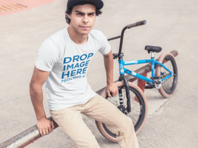 Tee Mockup of a Skater Guy with His Bike a11592