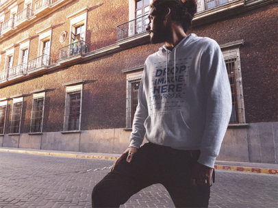 Pullover Hoodie Mockup of a Young Man with Long Hair at Sunset a12624