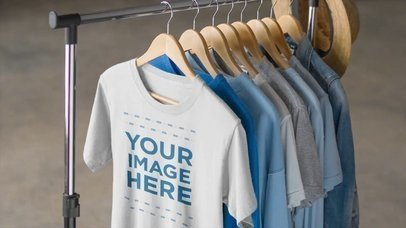 Simple Round Neck Tee Hanging on a Clothing Rack T-Shirt Mockup Video a13085-122316