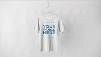 Tee Mockup Video of a Round Neck T-Shirt Hanging Over a White Background a13144