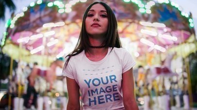 Beautiful Girl Wearing a Round Neck Tee With a Carousel Behind Cinemagraph Mockup  a13516