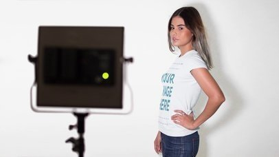 Stop Motion Mockup of a Pretty Model Posing at a Photo Shoot While Wearing a Short-Sleeved T-Shirt a13216